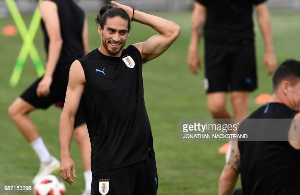 Uruguay's defender Martin Caceres reacts as he takes part in a training session of Uruguay's national football team at the Park Arena in Sochi on...