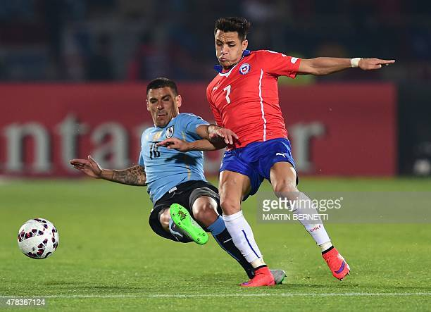 Uruguay's defender Maximiliano Pereira vies for the ball with Chile's forward Alexis Sanchez during their 2015 Copa America football championship...