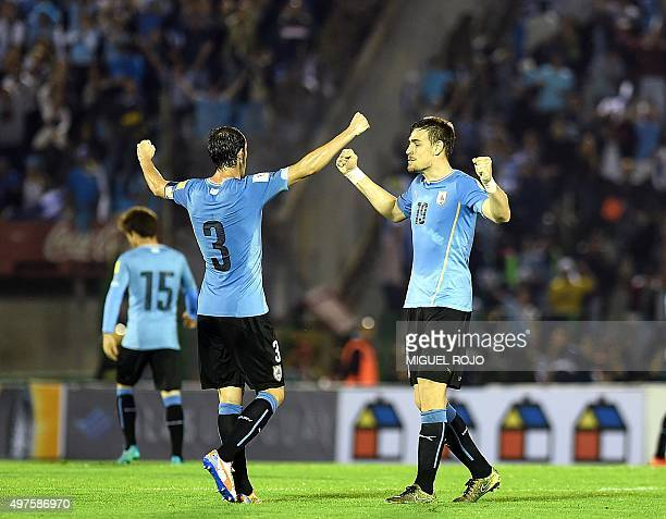 Uruguay's defenders Diego Godin and Sebastian Coates celebrate after defeating Chile 30 in a Russia 2018 FIFA World Cup South American Qualifiers...
