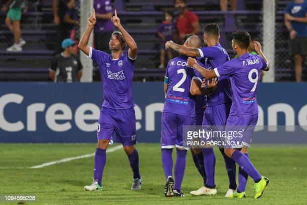 Uruguay's Defensor Sporting Alvaro Navarro celebrates with teammates after scoring against Ecuador's Barcelona during their Copa Libertadores...