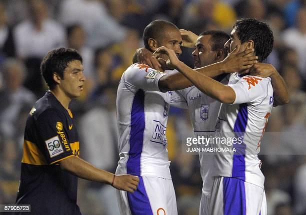 Uruguay's Defensor Sporting midfielder Diego De Souza celebrates with teammates midfielder Diego Ferreira and forward Diego Vera after scoring...
