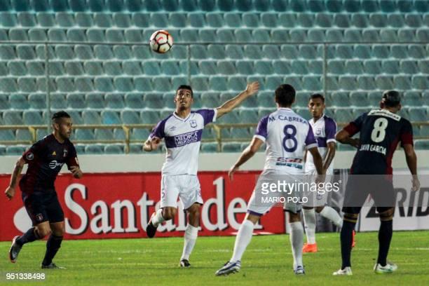 Uruguay's Defensor Sporting midfielder Martin Rabunal eyes the ball next to Venezuela's Monagas midfielder Christian Flores during their Copa...