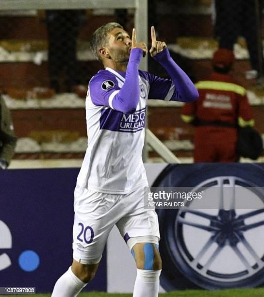 Uruguay's Defensor Sporting player Alvaro Navarro celebrates after scoring against Bolivia's Bolivar during their Copa Libertadores match at Hernando...