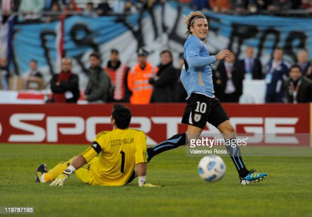 Uruguay's Diego Forlan kicks the ball to score against Paraguay during 2011 Copa America soccer final match at Antonio Vespucio Liberti stadium on...