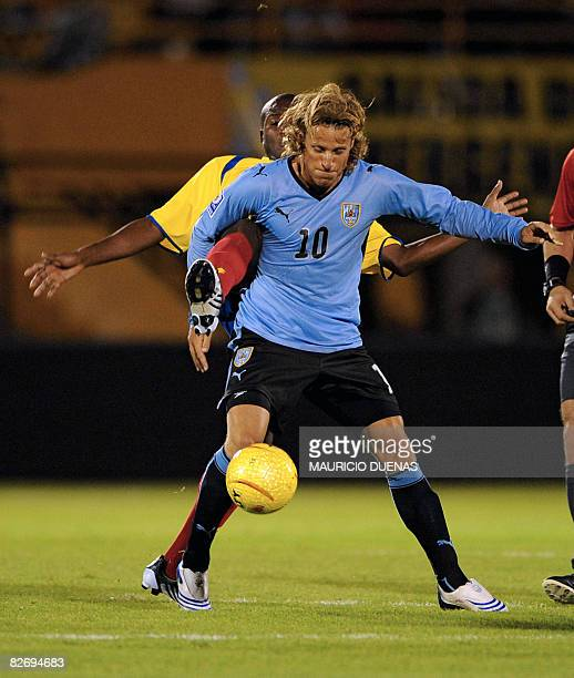 Uruguay's Diego Forlan protects the ball off Colombia's Aquivaldo Mosquera on September 6 in Bogota during their FIFA World Cup South Africa 2010...