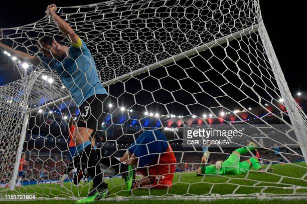 TOPSHOT Uruguay's Diego Godin and Chile's Gonzalo Jara and Chile's goalkeeper Gabriel Arias are seen during their Copa America football tournament...