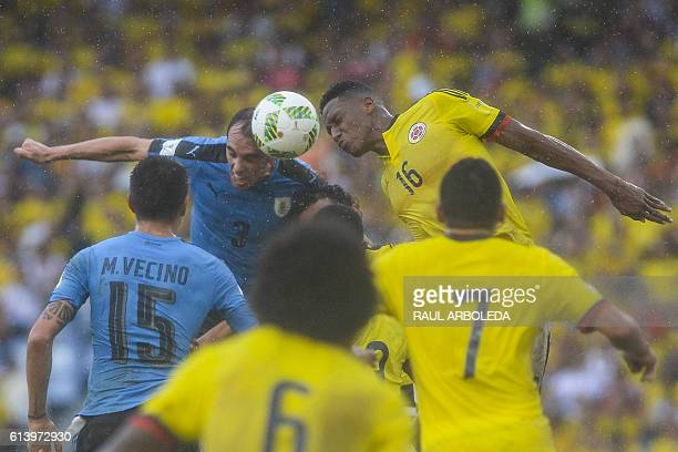 Uruguay's Diego Godin and Colombia's defender Yerry Mina head the ball next to Uruguay's Matias Vecino and Colombia's forward Carlos Bacca during...
