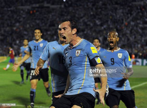 Uruguay's Diego Godin celebrates after scoring against Chile during their Russia 2018 FIFA World Cup South American Qualifiers football match in...