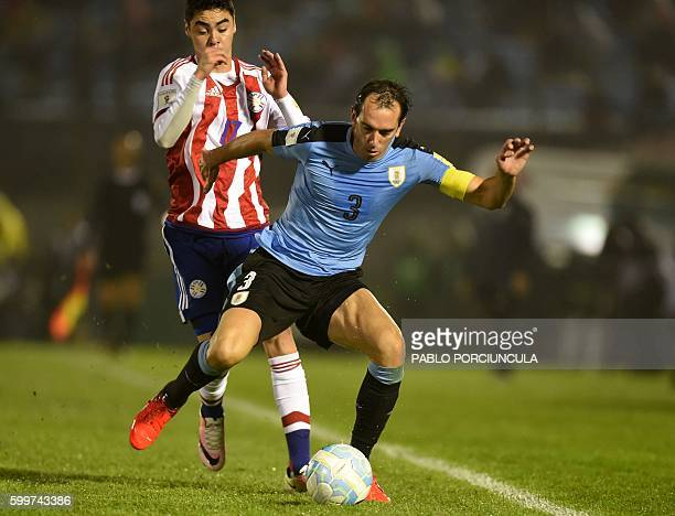 Uruguay's Diego Godin is marked by Paraguay's Miguel Almiron during their Russia 2018 World Cup football qualifier match in Montevideo on September 6...