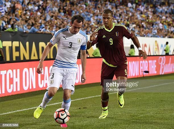 Uruguay's Diego Godin is marked by Venezuela's Jose Salomon Rondon during the Copa America Centenario football tournament in Philadelphia...