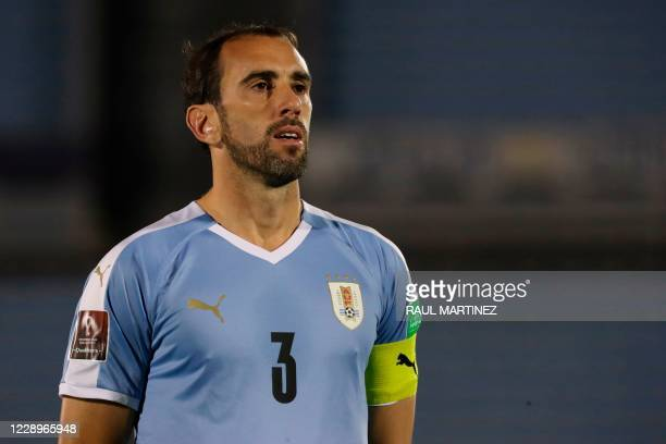 Uruguay's Diego Godin listens to the national anthem before the 2022 FIFA World Cup South American qualifier football match against Chile at the...