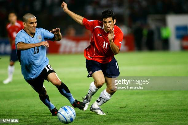 Uruguay's Diego Perez vies for the ball with Chile's Mark Gonzalez during their 2010 FIFA World Cup Qualifier at the National Stadium on April 1,...