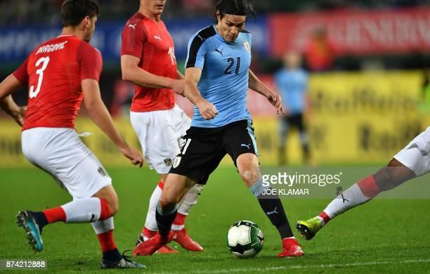 Uruguay's Edinson Cavani and Austria's Aleksandar Dragovic vie for the ball during the international friendly football match Austria v Uruguay in...