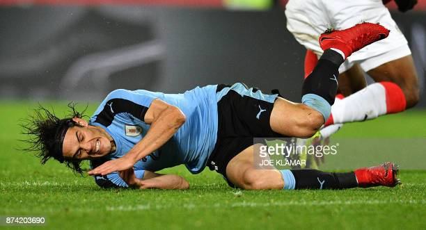 Uruguay's Edinson Cavani and Austria's Kevin Danso vie for the ball during the international friendly football match Austria v Uruguay in Vienna on...