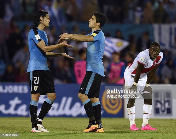 Uruguay's Edinson Cavani and Luis Suarez celebrate after defeating Peru 10 in a Russia 2018 FIFA World Cup South American Qualifiers' football match...