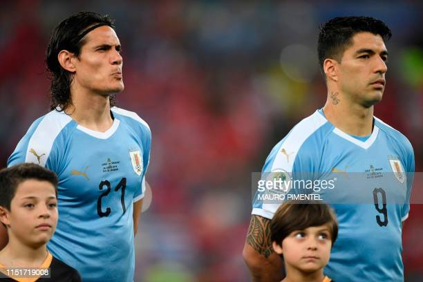 Uruguay's Edinson Cavani and Luis Suarez listen lo the national anthems before their Copa America football tournament group match against Chile at...