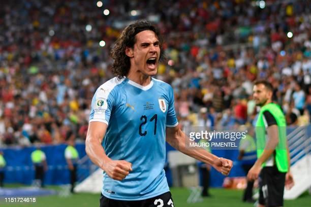 TOPSHOT Uruguay's Edinson Cavani celebrates after scoring against Chile during their Copa America football tournament group match at Maracana Stadium...
