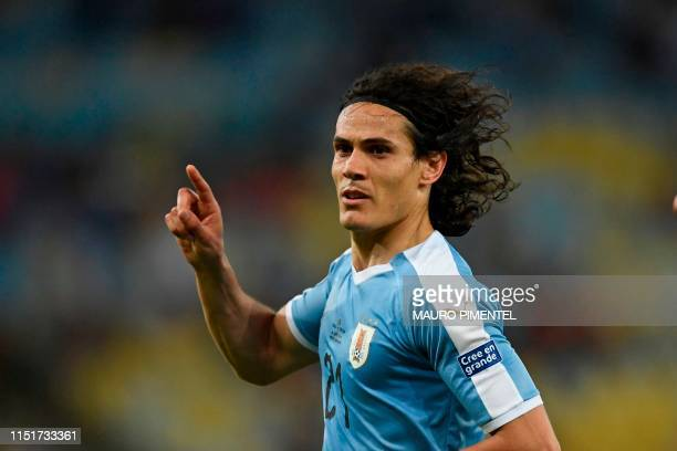 TOPSHOT Uruguay's Edinson Cavani celebrates after scoring against Chile during their Copa America football tournament group match at Maracana Stadium...