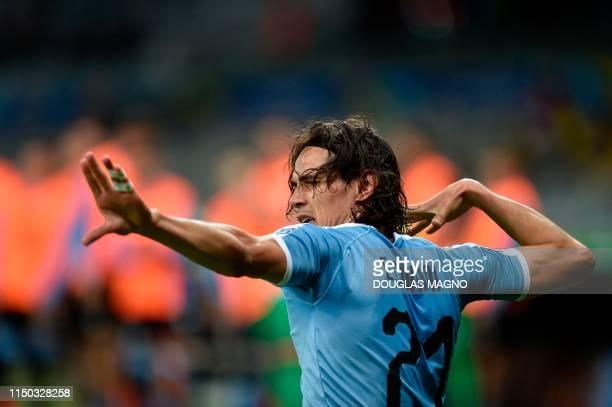 Uruguay's Edinson Cavani celebrates after scoring against Ecuador during their Copa America football tournament group match at the Mineirao Stadium...