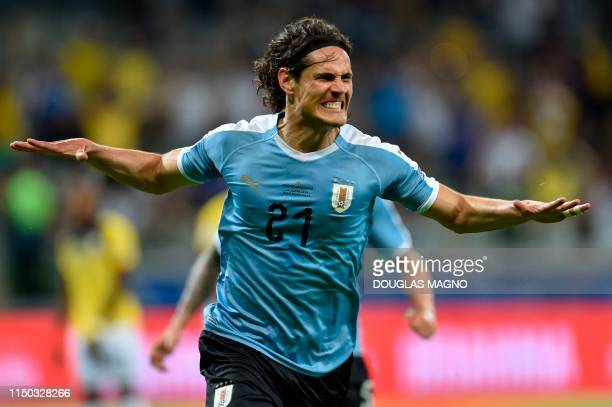 TOPSHOT Uruguay's Edinson Cavani celebrates after scoring against Ecuador during their Copa America football tournament group match at the Mineirao...
