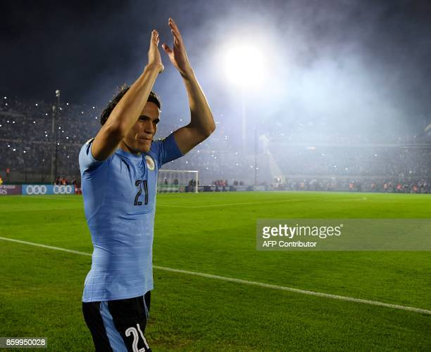 Uruguay's Edinson Cavani celebrates with supporters after defeating Bolivia 42 during their 2018 World Cup football qualifier match in Montevideo on...