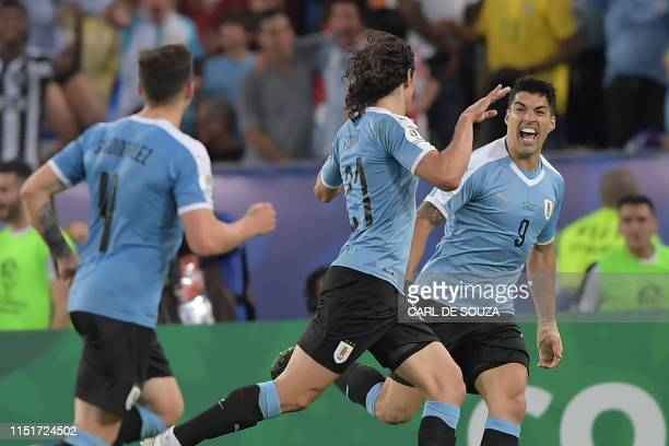 Uruguay's Edinson Cavani celebrates with teammate Luis Suarez after scoring against Chile during their Copa America football tournament group match...