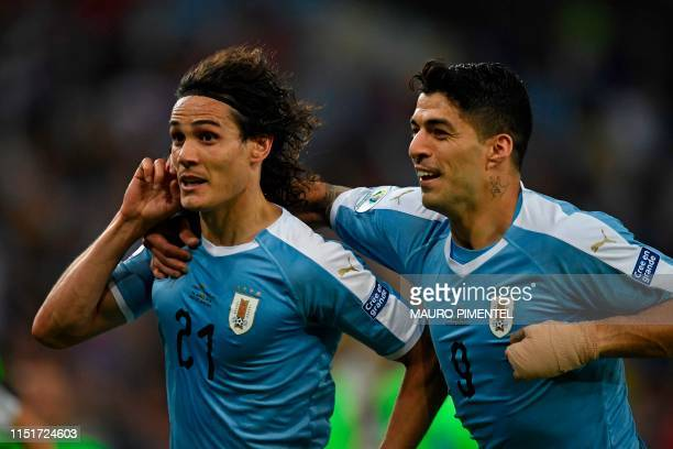 TOPSHOT Uruguay's Edinson Cavani celebrates with teammate Luis Suarez after scoring against Chile during their Copa America football tournament group...