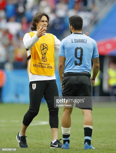 Uruguay's Edinson Cavani consoles teammate Luis Suarez after a 20 loss to France in a World Cup quarterfinal in Nizhny Novgorod Russia on July 6 2018...
