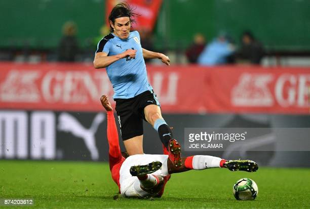 Uruguay's Edinson Cavani fights for the ball with Austria's Kevin Danso during the international friendly football match Austria v Uruguay in Vienna...