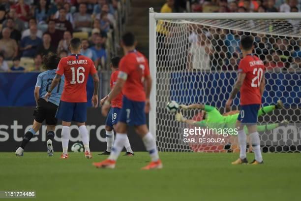 TOPSHOT Uruguay's Edinson Cavani scores past Chile's goalkeeper Gabriel Arias during their Copa America football tournament group match at Maracana...