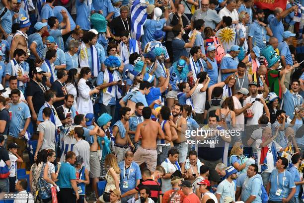 Uruguay's fans celebrate at the end of the Russia 2018 World Cup Group A football match between Uruguay and Saudi Arabia at the Rostov Arena in...