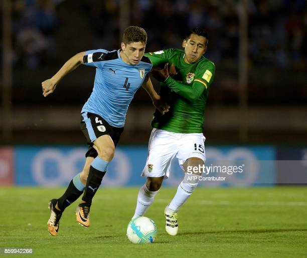Uruguay's Federico Valverde and Peru's Christian Ramos vie for the ball during their 2018 World Cup football qualifier match in Montevideo on October...