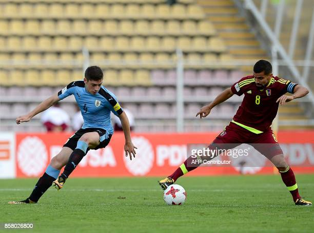 Uruguay's Federico Valverde and Venezuela's Tomas Rinconvie for the ball during their 2018 World Cup football qualifier match in San Cristobal...