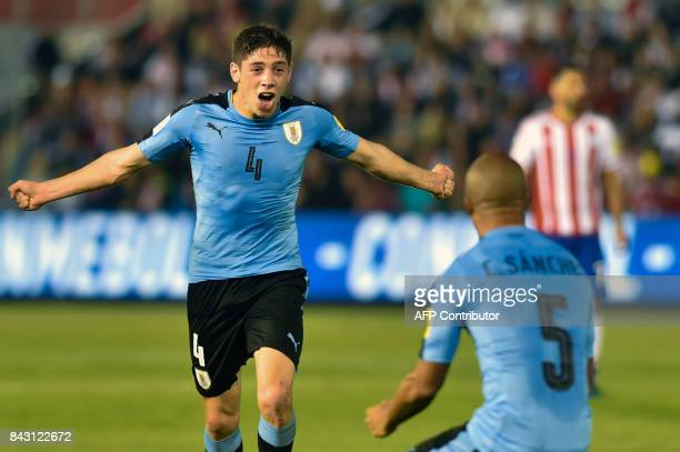 Uruguay's Federico Valverde celebrates with teammate Carlos Sanchez after scoring against Paraguay during their 2018 World Cup football qualifier...