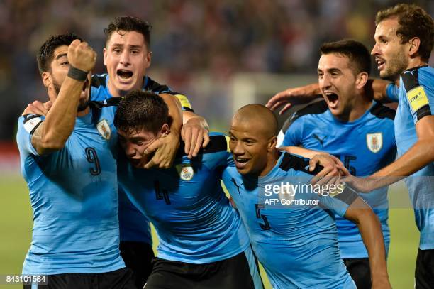 Uruguay's Federico Valverde celebrates with teammates after scoring against Paraguay during their 2018 World Cup football qualifier match in Asuncion...