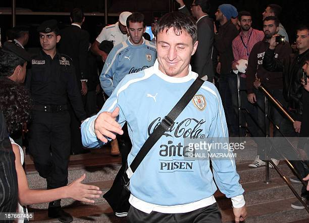 Uruguay's football player Cristian Rodriguez arrives with his team mates at the Meridien hotel in the Jordanian capital Amman on November 11 2013...