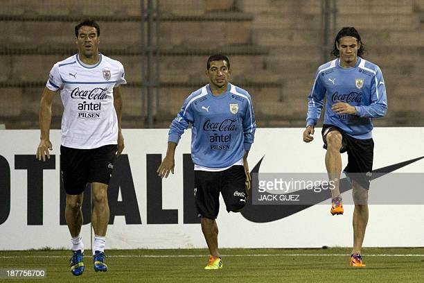 Uruguay's football players Edinson Cavani Walter Gargano and Andres Scotti attend a training session at Amman International Stadium on Novemeber 12...
