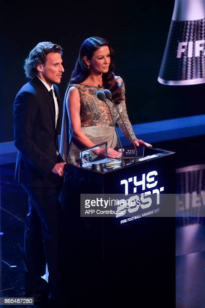 Uruguay's former player Diego Forlan and British actress Catherine ZetaJones present The 2017 FIFA Puskas Award during The Best FIFA Football Awards...