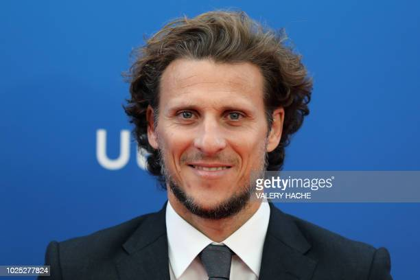 Uruguay's forward Diego Forlan poses upon his arrival for the draw of the UEFA Champions League football tournament at The Grimaldi Forum in Monaco...