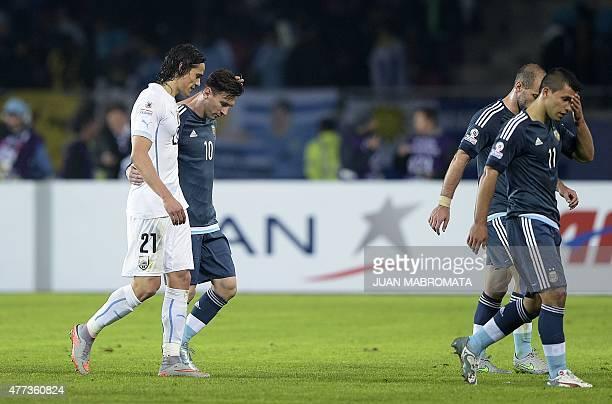 Uruguay's forward Edinson Cavani and Argentina's forward Lionel Messi speak during half time of their 2015 Copa America football championship match...