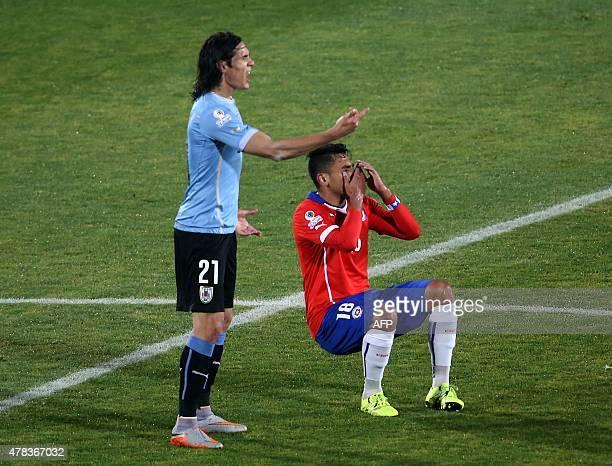 Uruguay's forward Edinson Cavani and Chile's defender Gonzalo Jara gesture during their 2015 Copa America football championship quarterfinal match in...