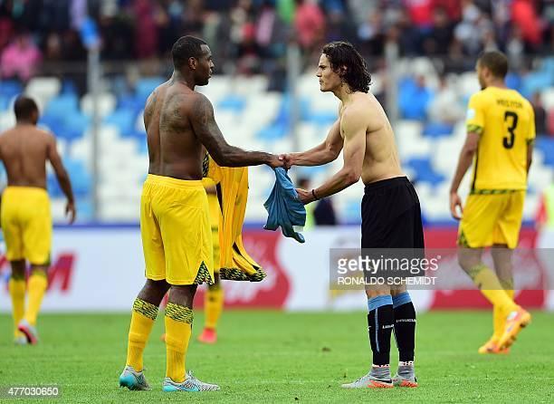 Uruguay's forward Edinson Cavani and Jamaica's defender Wesley Morgan exchange jerseys after their 2015 Copa America football championship match in...