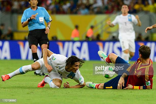 Uruguay's forward Edinson Cavani and Spain's defender Sergio Ramos fall during their FIFA Confederations Cup Brazil 2013 Group B football match, at...