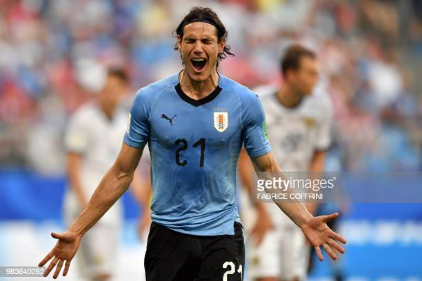 TOPSHOT Uruguay's forward Edinson Cavani celebrates after scoring a goal during the Russia 2018 World Cup Group A football match between Uruguay and...