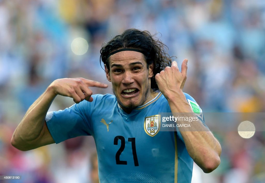 Uruguay's forward Edinson Cavani celebrates after scoring a penalty kick during a Group D football match between Uruguay and Costa Rica at the Castelao Stadium in Fortaleza during the 2014 FIFA World Cup on June 14, 2014.