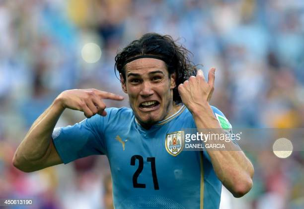 Uruguay's forward Edinson Cavani celebrates after scoring a penalty kick during a Group D football match between Uruguay and Costa Rica at the...