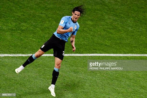 Uruguay's forward Edinson Cavani celebrates after scoring a second goal during the Russia 2018 World Cup round of 16 football match between Uruguay...