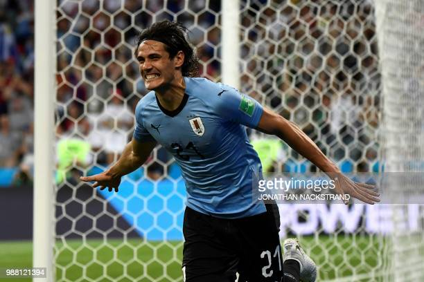 TOPSHOT Uruguay's forward Edinson Cavani celebrates after scoring the opening goal during the Russia 2018 World Cup round of 16 football match...