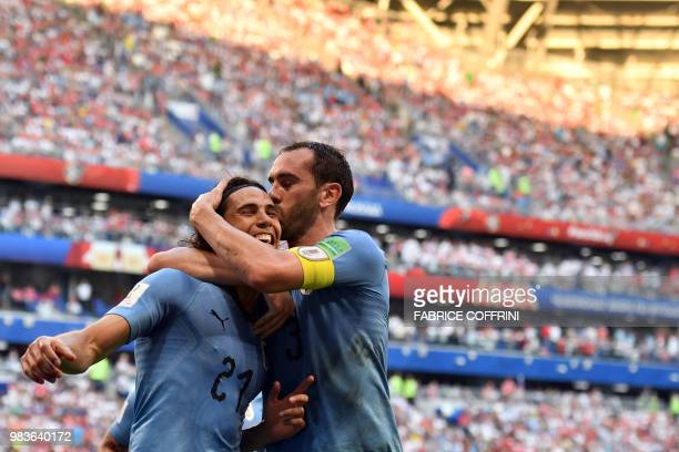 TOPSHOT Uruguay's forward Edinson Cavani celebrates with Uruguay's defender Diego Godin after scoring a goal during the Russia 2018 World Cup Group A...