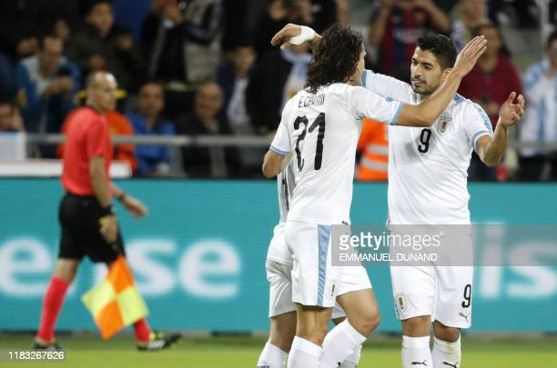 Uruguay's forward Edinson Cavani celebrates with Uruguay's forward Luis Suarez after scoring during the friendly football match between Argentina and...